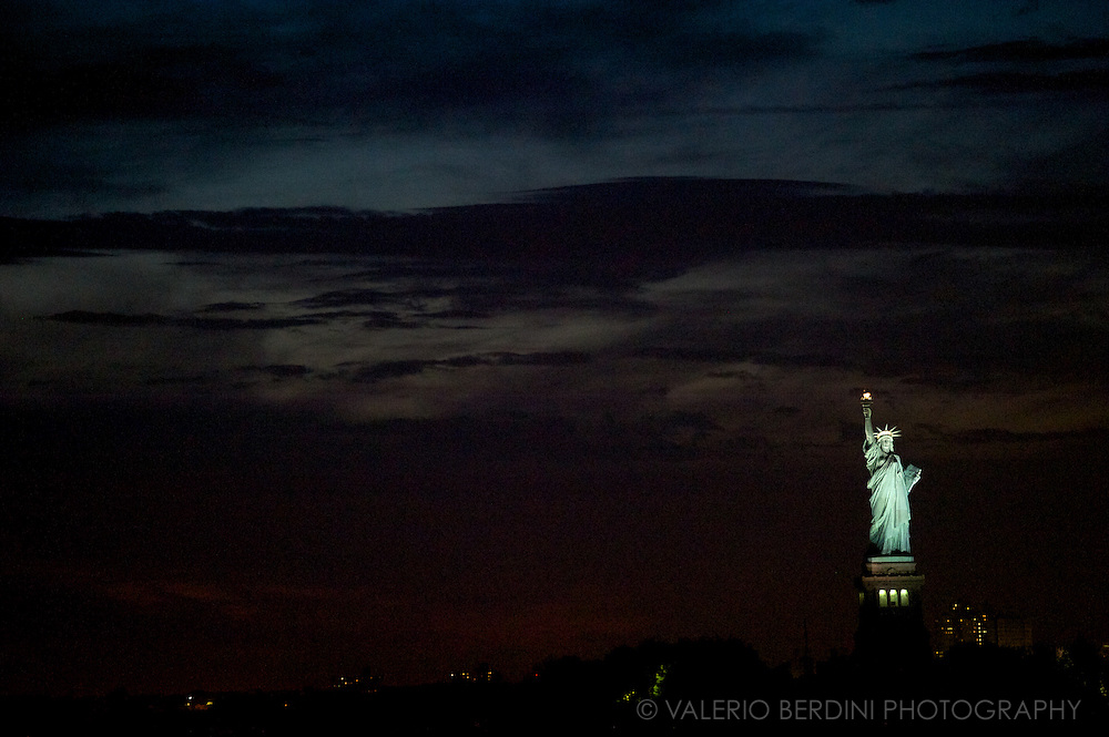 Black Flag. The statue of Liberty under moonlight. New York City, USA.
