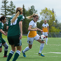 3rd year midfielder Nikita Senko (9) of the Regina Cougars navigates her way through midfield during the Women's Soccer Homeopener on September 10 at U of R Field. Credit: Arthur Ward/Arthur Images