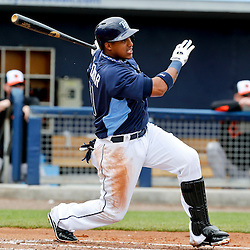 Mar 2, 2013; Port Charlotte, FL, USA; Tampa Bay Rays shortstop Yunel Escobar (11) hits a single against the Baltimore Orioles during the bottom of the first inning of a spring training game at Charlotte Sports Park. Mandatory Credit: Derick E. Hingle-USA TODAY Sports