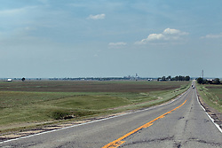 US Route 136 stretches through central Illinois in and east-west direction transporting land vehicles carrying travelers and cargo