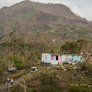 OCTOBER 18 - LAS MARIAS, PUERTO RICO - <br /> Mercy Corps staffers walk up to a farm house in Las Marias as they conduct field research to find out what residents need for supplies following the destructive path of hurricane Maria.<br /> (Photo by Angel Valentin for NPR)