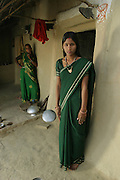IND.MWdrv04.327.x..Bachau and Mishri Yadav's oldest child, daughter Nishadevi, 19, called Guddi, is betrothed by family arrangement to a boy living in a village 30 km from her home village of Ahraura Village, Uttar Pradesh, India. Revisit with the family, 2004. The Yadavs were India's participants in Material World: A Global Family Portrait, 1994 (pages: 64-65), for which they took all of their possessions out of their house for a family-and-possessions-portrait. Child, Children, Marriage..