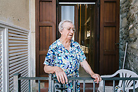 ACCIAROLI, ITALY - 14 SEPTEMBER 2018: Anna Vassallo (91) is seen here in front of her house in Acciaroli, a small fishing village in the municipality of Pollica, Italy, on September 14th 2018.<br /> <br /> To understand how people can live longer throughout the world, researchers at University of California, San Diego School of Medicine have teamed up with colleagues at University of Rome La Sapienza to study a group of 300 citizens, all over 100 years old, living in Acciaroli (Pollica), a remote Italian village nestled between the ocean and mountains in Cilento, southern Italy.<br /> <br /> About 1-in-60 of the area's inhabitants are older than 90, according to the researchers. Such a concentration rivals that of other so-called blue zones, like Sardinia and Okinawa, which have unusually large percentages of very old people. In the 2010 census, about 1-in-163 Americans were 90 or older.