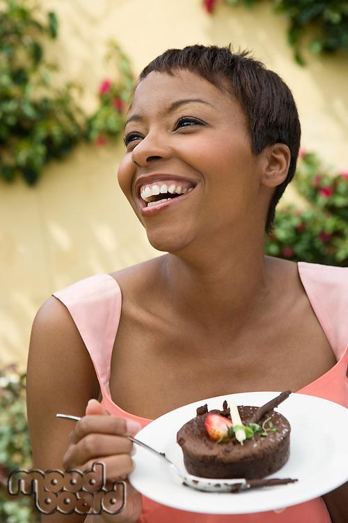 Woman eating dessert outdoors