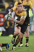 Hurricanes' TJ Perenara runs the ball during the Hurricanes vs Highlanders Super Rugby  match at the Westpac Stadium in Wellington on Friday the 27th of May 2016. Copyright Photo by Marty Melville / www.Photosport.nz
