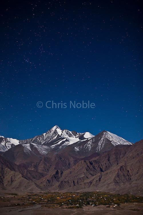 Night time photograph of the village of Stok, Ladakh  below Stok Kangri Peak.