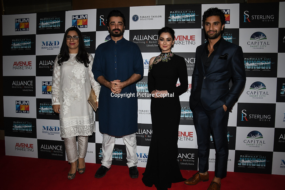 """Producer and Hamza Ali ,Hania Amir and Ahad Raza Mir star of the movie attend Photocall in London Premiere of """"Parwaaz Hai Junoon"""" (Soaring Passion) as featured on SKY, ITV at The May Fair Hotel, Stratton Street, London, UK. 22 August 2018."""