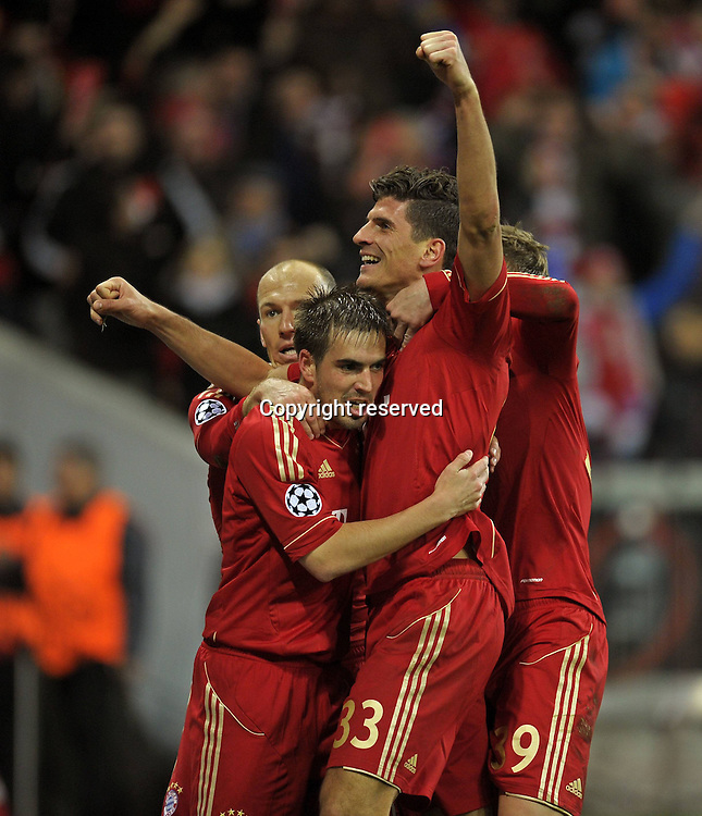 17.04.2012. Munich, Germany, UEFA Champions League football semi final. Bayern Munich versus Real Madrid, Leg 1 in the Alliance Arena Munich. Mario Gomez of Munich with his goal celebration left Philipp Lahm Bavaria Munich  . Bayern ran out the winners by a score of 2-1 on the night.