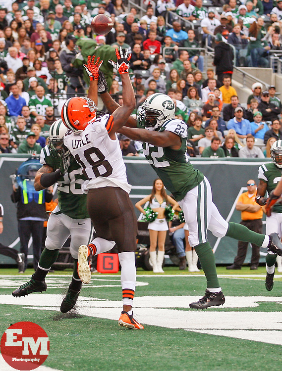 Dec 22, 2013; East Rutherford, NJ, USA; New York Jets defensive back Aaron Berry (22) breaks up a pass intended for Cleveland Browns wide receiver Greg Little (18) in the end zone during the first half at MetLife Stadium.