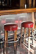 San Francisco, California, July 20, 2008-Two bar stools at Tosca Cafe. For almost 80 years this bar has remained untouched. Two large, antique espresso machines, a long bar, original red vinyl booths, and a vintage jukebox with the original records all lie within the historic deco structure.