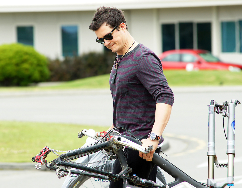 Orlando Bloom, filming in the Hobbit movies arrives at the airport withg his bike in Nelson, New Zealand, Wednesday, December 07, 2011. Credit:SNPA / Ross Wearing