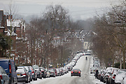 A car descends an icy minor road in the south London borough of Herne Hill, Lambeth during the bad weather covering every part of the UK and known as the 'Beast from the East' because Siberian winds and very low temperatures have blown across western Europe from Russia, on 1st March 2018, in Lambeth, London, England.