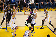 Golden State Warriors guard Stephen Curry (30) fouls LA Clippers guard Austin Rivers (25) during a lay up attempt at Oracle Arena in Oakland, Calif., on February 23, 2017. (Stan Olszewski/Special to S.F. Examiner)