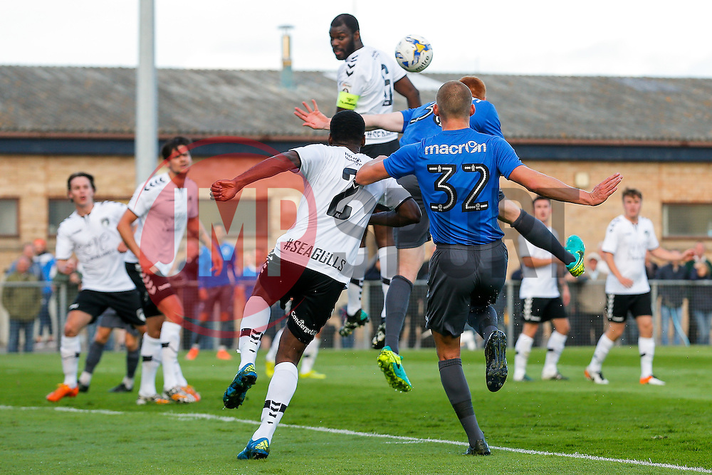 Rory Gaffney of Bristol Rovers (obstructed by Alfie Kilgour) scores a headed goal to make it 0-1 - Mandatory by-line: Rogan Thomson/JMP - 13/07/2016 - SPORT - Football - Woodspring Stadium - Weston-super-Mare, England - Weston-super-Mare AFC v Bristol Rovers - Pre Season Friendly.