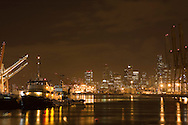 Seattle skyline with tug boat at terminal docks