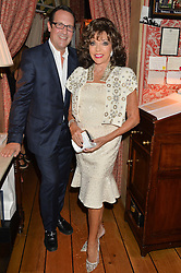 JOAN COLLINS and PERCY GIBSON at a party to celebrate 35 years of Harry's Bar, 26 South Audley Street, London on 19th September 2014.