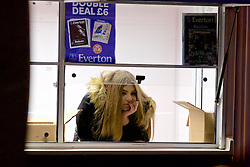 LIVERPOOL, ENGLAND - Monday, December 19, 2016: A programme seller outside Everton's Goodison Park ahead of the FA Premier League match against Liverpool, the 227th Merseyside Derby, at Goodison Park. (Pic by David Rawcliffe/Propaganda)