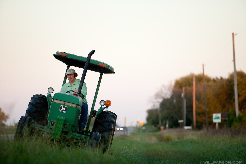 J Parson cuts the grass outside his Girard, Kansas  pasture.