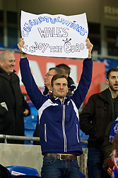 """CARDIFF, WALES - Tuesday, October 13, 2015: An Andorra supporter with a banner """"Congratulations Wales Enjoy the Euro"""" before the UEFA Euro 2016 qualifying Group B match at the Cardiff City Stadium. (Pic by David Rawcliffe/Propaganda)"""
