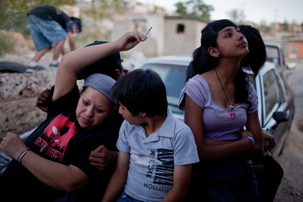 Family and friends hang out in Diaz Ordaz colonia, a gang area, in Ciudad Juarez, Chihuahua Mexico on May 7, 2010. ..