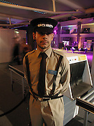 Secruity Guard. Fundraising party with airline theme in aid of the Old Vic and to celebrate the appointment of Kevin Spacey as artistic director.  <br />Old Billinsgate Market.  5 February 2003. © Copyright Photograph by Dafydd Jones 66 Stockwell Park Rd. London SW9 0DA Tel 020 7733 0108 www.dafjones.com