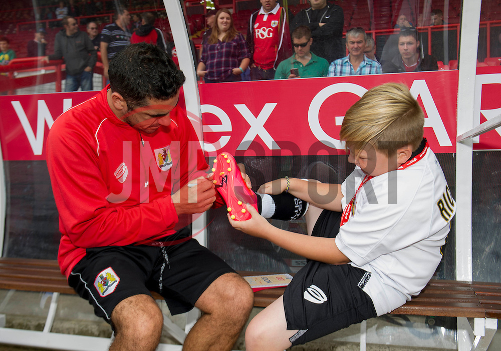 Bristol City's Scott Murray signs a young fans football boot - Photo mandatory by-line: Dougie Allward/JMP - Mobile: 07966 386802 16/08/2014 - SPORT - FOOTBALL - Bristol - Ashton Gate - Bristol City v Colchester United - Sky Bet League One