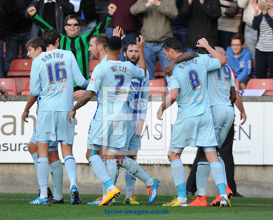Jim O'Brien (centre) of Coventry City celebrates after scoring the opening goal with his team mates during the Sky Bet League 1 match at the Matchroom Stadium, London<br /> Picture by Alan Stanford/Focus Images Ltd +44 7915 056117<br /> 01/11/2014