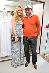 NOELLE RENO and SCOT YOUNG at the opening of the new Melissa Odabash store in Walton Street, London SW3 on 7th July 2011.