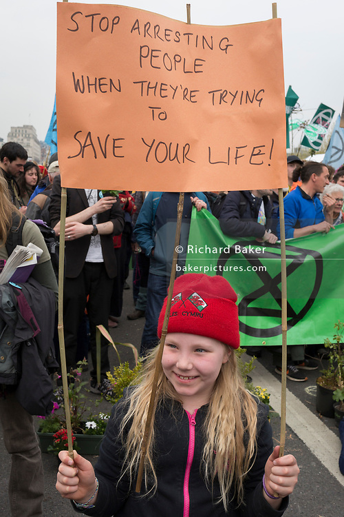 A young Climate Change activist with Extinction Rebellion campaigns for a better future for planet Earth after blocking Waterloo Bridge and as part of a multi-location 5-day Easter protest around the capital, on 16th April 2019, in London, England.