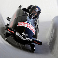 01 March 2009:     The USA 2 bobsled driven by Todd Hays with sidepushers T.J. Burns and Alex Sprague, and brakeman  Bill Schuffenhauer drives through turn 19 in the 3rd run at the 4-Man World Championships competition on March 1 at the Olympic Sports Complex in Lake Placid, NY.   The USA 1 bobsled driven by Steven Holcomb with sidepushers Justin Olsen and Steve Mesler, and brakeman Curtis Tomasevicz won the competition and the World Championship bringing the U.S. their first world championship since 1959 with a time of 3:36.61.