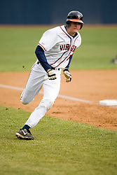 Virginia Cavaliers OF Jarrett Parker (13) rounds third base on his way to home.  The #17 ranked Virginia Cavaliers baseball team defeated the Lehigh Mountain Hawks 12-1 at the University of Virginia's Davenport Field in Charlottesville, VA on February 24, 2008.