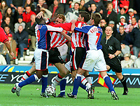 Andy Cole (Blackburn) clashes with Michael Svensson and is sent off by Referee Mr.Steve Bennett. Southampton v Blackburn Rovers. 25/10/03. Credit : Colorsport/Andrew Cowie.
