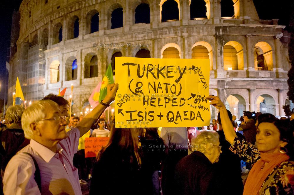 Roma 8  Ottobre 2014<br /> Manifestazione delle associazioni dei curdi a Roma al Colosseo per &laquo;salvare la citt&agrave; di Kobane, dall'avanzata dell'Isis&raquo;. La marcia di solidariet&agrave; al popolo curdo sostiene la resistenza di Kobane, la citt&agrave; a nord della Siria al confine con la Turchia sulla quale procede  l'avanzata dell'Isis.<br /> Rome October 8, 2014 <br /> Demostration of Kurdish Associations in Rome  at the Colosseum  to &quot;save the city of Kobane, by the advance of the Isis.&quot; The march of solidarity with the Kurdish people support the resistance of Kobane, the city in northern Syria on the border with Turkey on which proceeds  the advance  of the  Isis.