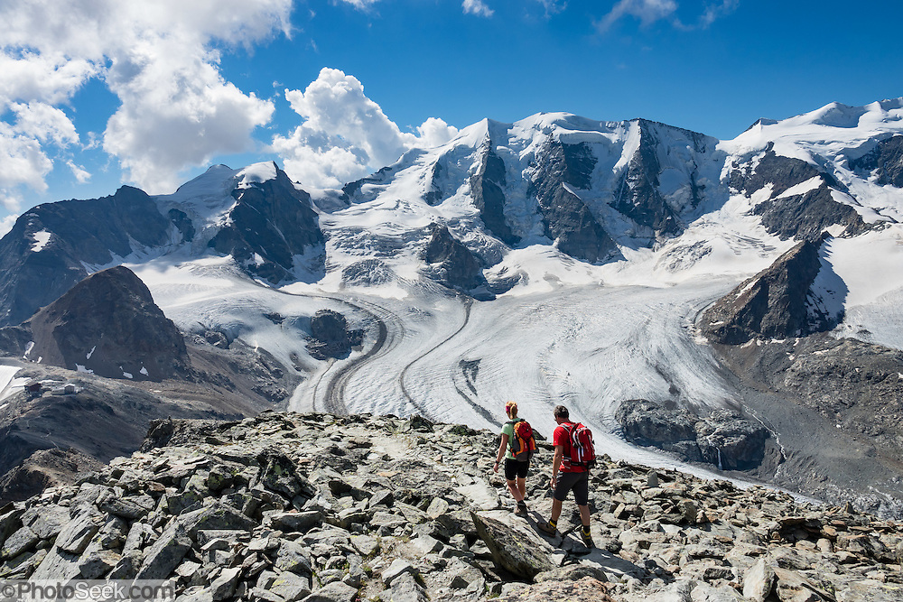 """Ride Bernina-Diavolezza lift for spectacular views of the Bernina Range. If not afraid of heights at Diavolezza, don't miss the scenic, rocky hike to Munt Pers which gains 265 meters over 2 km one way. Upper Engadine is in Graubünden (Grisons) canton, Switzerland, the Alps, Europe. The Swiss valley of Engadine translates as the """"garden of the En (or Inn) River"""" (Engadin in German, Engiadina in Romansh, Engadina in Italian)."""
