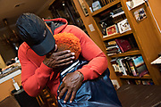 Following an hour-long bible study lesson, Bunchie is embraced by his dad Dave Young. Faith plays almost as large a part in their lives as football does.