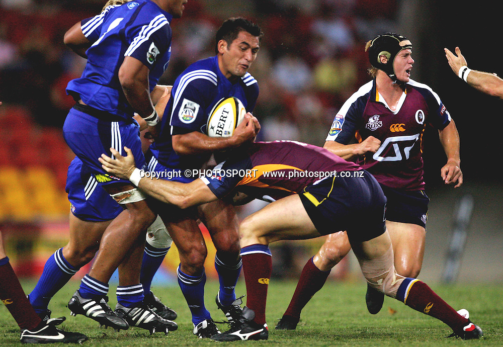 Nick Williams belts the defence of avid Croft during the 2006 Super 14 rugby union match between the Reds and the Auckland Blues at Suncorp Stadium, Brisbane, Australia, on Saturday 25 February, 2006.Blues defeated Reds 21-20. Photo: PHOTOSPORT