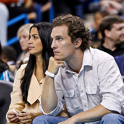 December 15, 2010; Hollywood actor Matthew McConaughey and model Camila Alves watch courtside during a game between the Sacramento Kings and the New Orleans Hornets at the New Orleans Arena. Mandatory Credit: Derick E. Hingle