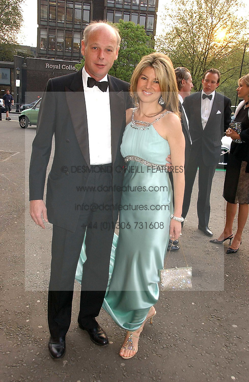 The HON.CHARLES &amp; MRS HAMBRO at the NSPCC's Dream Auction held at The Royal Albert Hall, London on 9th May 2006.<br />