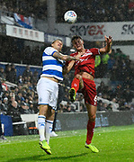 Dael Fry (6) of Middlesbrough battles for possession with Jordan Hugill (9) of Queens Park Rangers during the EFL Sky Bet Championship match between Queens Park Rangers and Middlesbrough at the Kiyan Prince Foundation Stadium, London, England on 9 November 2019.