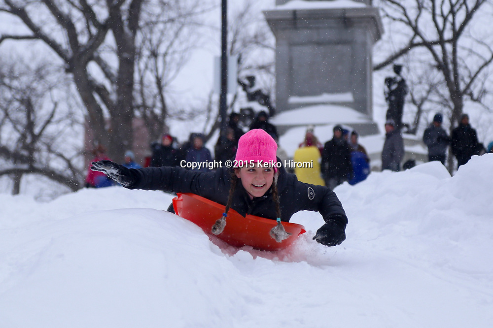 January 27 2015, Boston, MA USA: People enjoy skiing and snowboarding at Boston Common in Boston, MA.  Massachusetts was pounded by snow and lashed by strong winds early Tuesday as bands of heavy snow left some towns including Sandwich on Cape Cod and Oxford in central Massachusetts reporting more than 18 inches of snow.