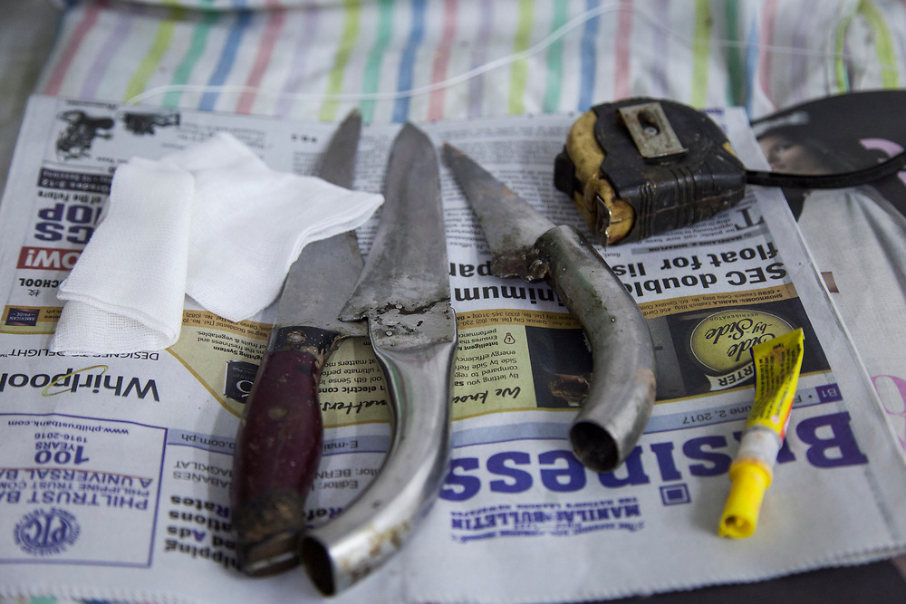 Tools used by the to prep dead bodies at Eusebio morgue in Navotas, Manila. <br /> <br /> Over 12 thousand people including men, women and even young teens who are mostly the urban poor, have been killed since President Duterte initiated the campaign against drugs. The killings or executions are carried out by masked gunmen. Bodies in morgue showed signs that the victims were bound or handcuffed but the police report often states they fought back or tried to run away.
