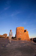 350310-1007 ~ Copyright: George H. H. Huey ~ National Park Service Ranger Julia Bell at The Castle, Ancestral Pueblo Indian site, Hovenweep National Monument, Utah/Colorado.