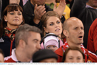 29 June 2013; Amy Huberman and daughter Saide watch on ahead of the game. British & Irish Lions Tour 2013, 2nd Test, Australia v British & Irish Lions, Ethiad Stadium, Melbourne, Australia. Picture credit: Stephen McCarthy / SPORTSFILE