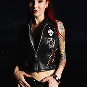 Tatto artist Lea Vendetta modeling a custom vest created by a member of the band Nashville Pussy especially for Lea Vendetta. Shot by Thomas Filipkowski in Key West, Florida July 2009