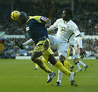 Photo: Aidan Ellis.<br /> Leeds United v Derby County. Coca Cola Championship. 09/12/2006.<br /> Derby's Darren Moore beats Leeds Ugo Ehiogu to the ball