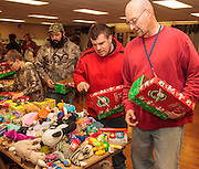 people filling gift boxes