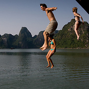 Bathers jump off boat into waters of Halong Bay (Halong Bay (Descending Dragon), Vietnam - Nov. 2008) (Image ID: 081114-1449152a)
