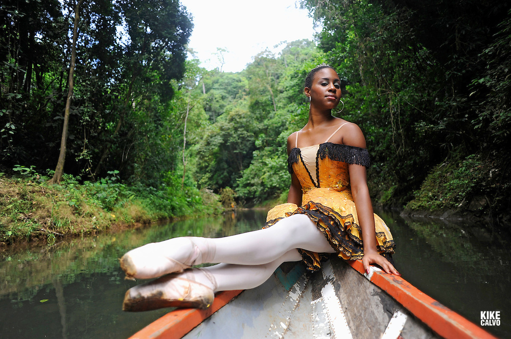 MR. Model relased photo of dancer from the National Ballet of Panama Eileen Frazer, posing on a wooden canoe in the Chagres River in Panama. MR. Model relased photo.
