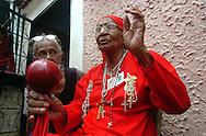Petra Rafaela González, primera mujer capataz de los Diablos de Yare desde 1935. .La festividad del Corpus Christi es una celebración conocida en Venezuela a través del ritual mágico-religioso de los Diablos Danzantes de Yare, que se celebra desde el siglo XVIII en esta población del estado Miranda. Cada Jueves Santo se hace una danza ritual de los llamados diablos, los cuales visten trajes coloridos (completamente de rojo), capas y máscaras de apariencia grotesca, además de adornos como cruces, escapularios, rosarios y otros amuletos, 15-06-2006. (ivan gonzalez)