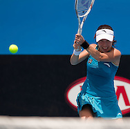 Jie Zheng (CHN)<br /> 2010 Australian Open Tennis<br /> Womens Singles<br /> First Round<br /> 18/01/10<br /> Jie Zheng of China hits a backdhand<br /> &quot;Court 8&quot; Melbourne Park, Melbourne, Victoria, Australia<br /> Photo By Lucas Wroe